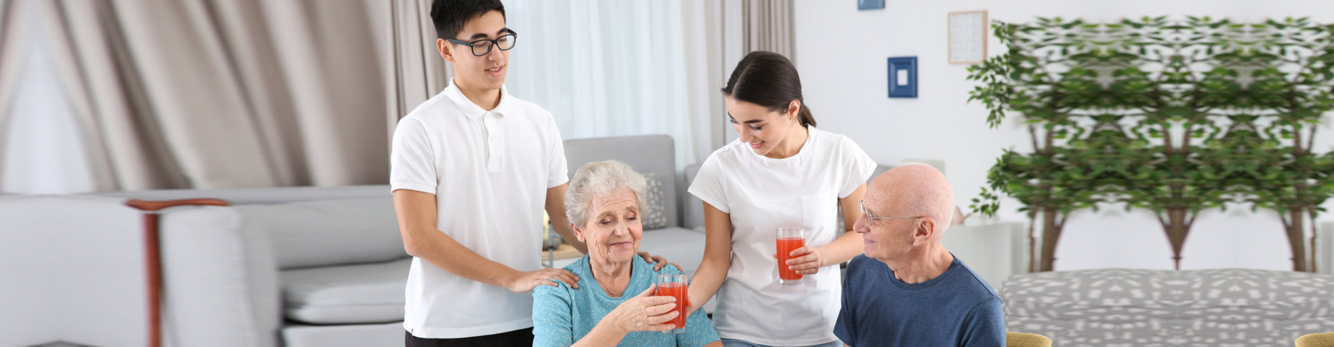 caregivers assisting the old couple